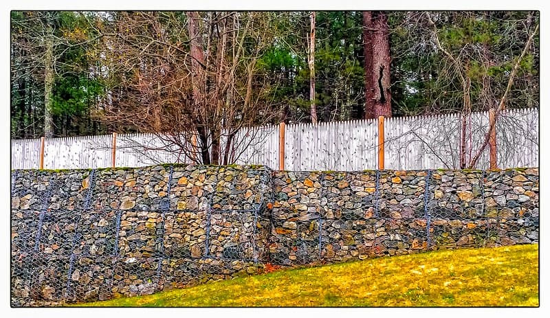 retaining wall next to privacy fence?
